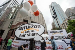 workers organizing for Amazon to pay it's fair share
