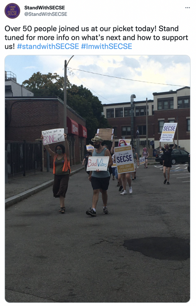 """sex shop workers in Boston on strike - text reads """"over 50 people joined our picket today!"""""""